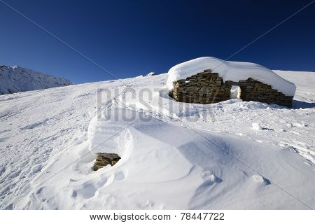 Old Pasture Huts In Scenic Winter Background