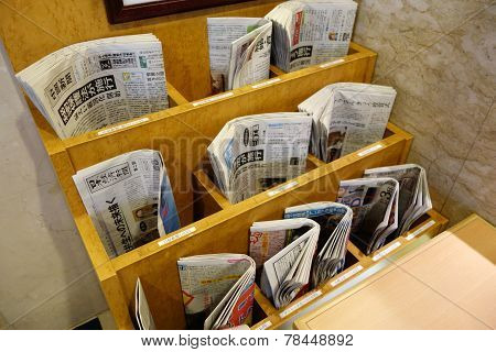 Various Of Newspapers Located In The Rack In Kyoto