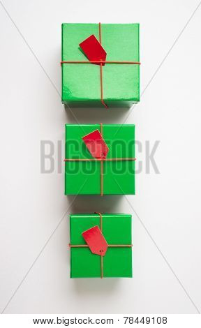 Group of various sizes green color gift boxes arranged in a row. Bird eye view.