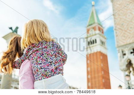 Mother And Baby Looking On Campanile Di San Marco In Venice, Ita