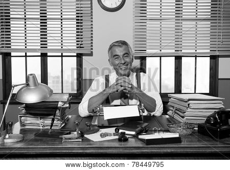 Smiling Retro Reporter Working At Office Desk