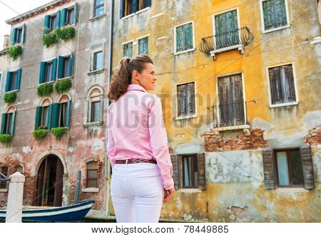 Young Woman In Venice, Italy Against Old Buldings