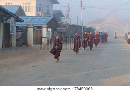 Young Monks Get Food Offerings In Early Morning