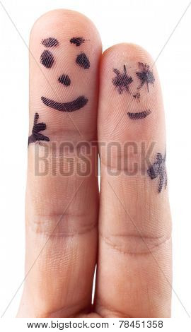 Smileys of family painted on man's fingers.