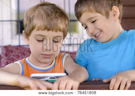 Happy Kids Staring At A Smart Phone