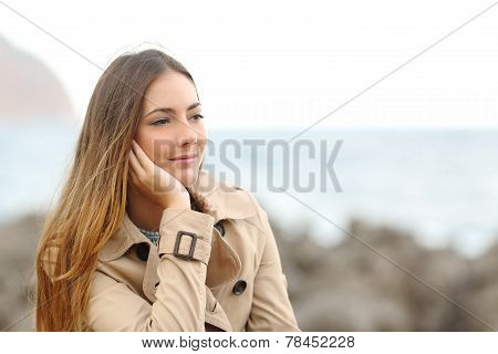 Beautiful Melancholic Woman Thinking In Winter On The Beach