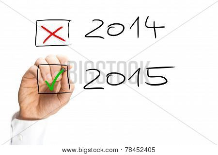 Man Ticking The Start Of The 2015 New Year