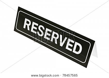 Reserved sign for restaurant table isolated on white background