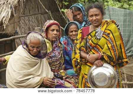 Women wait for their husbands from fishing, Mongla, Bangladesh.