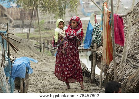 Woman takes care of her son, Mongla, Bangladesh.
