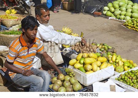 Men sell fruits at the local market in Bandarban, Bangladesh.