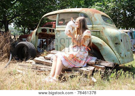 country girl playing with a rabbit