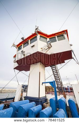 Captain bridge located on huge cargo ship