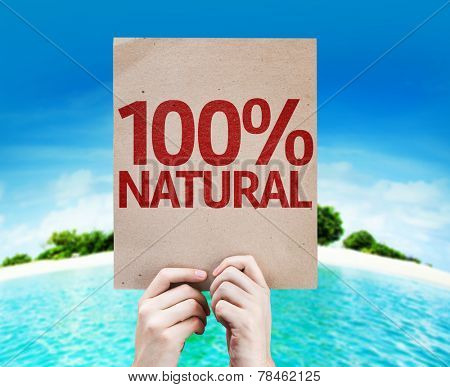 100% Natural card with a beach background