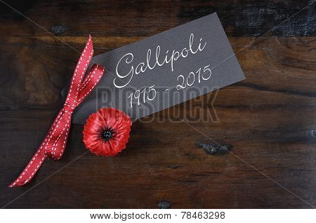Australian Gallipoli Centenary, Wwi, April 1915, Tribute With Red Poppy Lapel Pin Badge On Dark Recy