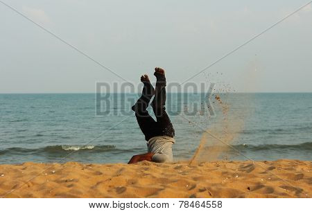Man Head Over Heels On The Beach In India