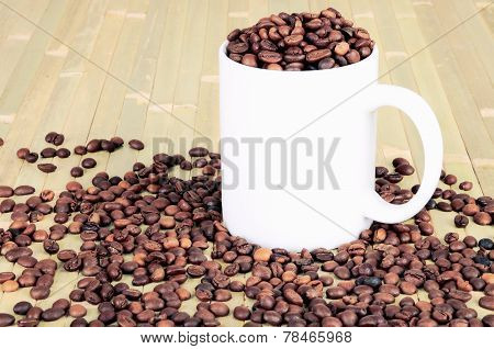 White Cup With Coffee Beans Is On A Wooden Table. Tinted Image