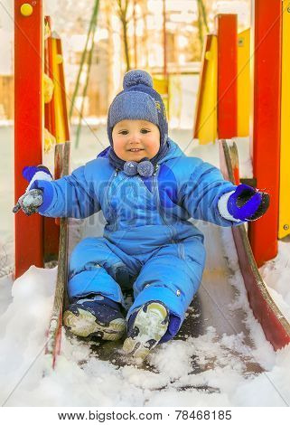 Happy Kid On Children Playground In Winter