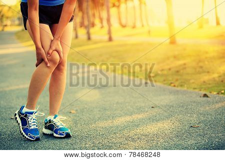 woman runner sports injured leg