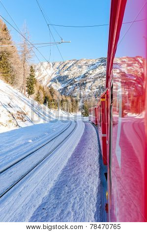 Bernina express train across Swiss Alps