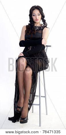 Female model in black evening dress