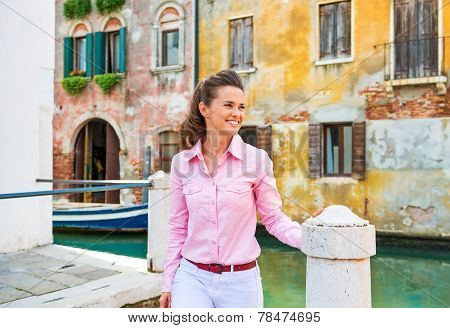 Happy Young Woman Walking In Venice, Italy