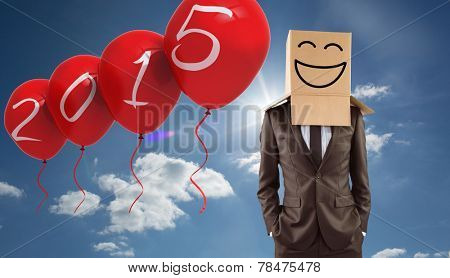 Anonymous businessman with hands in pockets against cloudy sky with sunshine