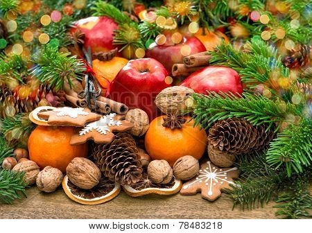 Fruits, Cookies And Spices. Christmas Background With Lights
