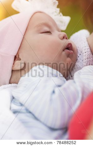 Newborn Baby Girl On Mothers Hands