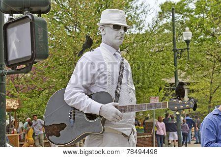 Man In White Busker