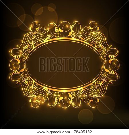Beautiful floral decorated golden frame in oval shape on shiny brown background.