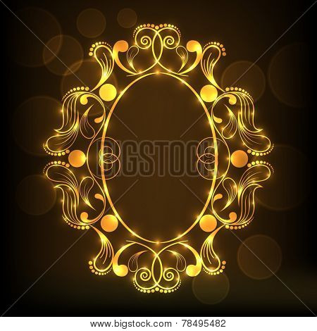 Shiny golden frame decorated by beautiful floral design in oval shape on brown background.