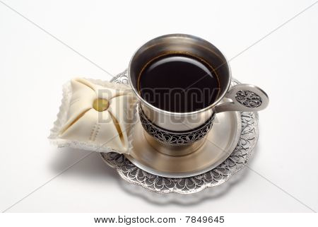 Silver Cup Of Coffee With Cake
