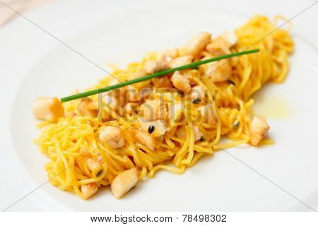 Pasta with fish and passionfruit sauce in plate