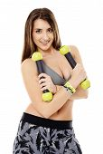 stock photo of cardio exercise  - Fitness young woman doing cardio aerobic exercises with light dumbbells - JPG