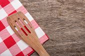 stock photo of crotch  - Wooden spoon fork on red napkin for a table - JPG