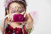 picture of face painting  - Little girl with face painting holding a snapshot camera - JPG