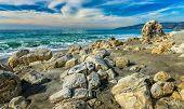stock photo of bluff  - Dramatic rocks on the beach of Point Dume State Beach in Malibu California - JPG
