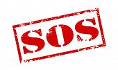 image of sos  - Rubber stamp with text SOS inside vector illustration - JPG