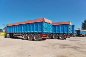 stock photo of truck farm  - Trucks with grain waiting for the unloading the elevator - JPG