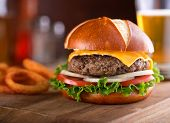 image of pretzels  - A delicious gourmet cheeseburger on a pretzel bun with lettuce onion and tomato - JPG