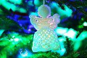 image of christmas angel  - Knitted Christmas angel on Christmas lights background - JPG