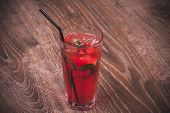 foto of mojito  - strawberry mojito cocktail with straw in glass - JPG