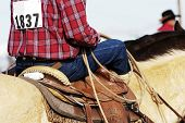 image of brahma-bull  - A cowboy waits to compete in the roping competition - JPG