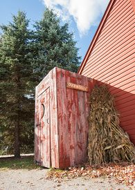 stock photo of outhouse  - Old outhouse on end of building - JPG