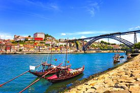 stock photo of historical ship  - Oporto or Porto city skyline Douro river traditional boats and Dom Luis or Luiz iron bridge - JPG