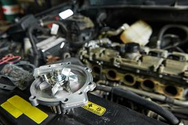 picture of combustion  - auto repair spare part turbine during automobile car maintenance at engine repair service station garage - JPG