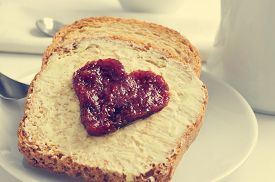 stock photo of continental food  - jam forming a heart on a toast - JPG
