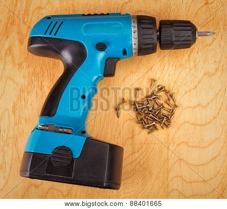 Electric drill and screws