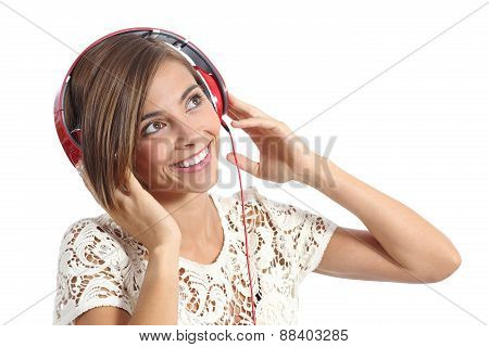 Happy Girl Enjoying And  Listening To The Music With Headphones